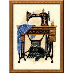 857. Cat with sewing machine